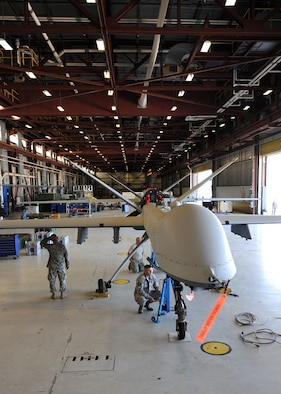 Members of the 174th Fighter Wing Maintenance Group prepare a MQ-9 Reaper for its initial taxi at Wheeler-Sack Army Air Field at Ft. Drum, NY, on 30 June 2011. The pre-taxi activity took place in temporary hanger space provided by the U.S. Army's 10th Mountain Division. This milestone represented the unit's first step toward flying the MQ-9 from its detachment at Ft. Drum.  The wing is based at Hancock Field in Syracuse, New York.  (US Air Force photo by Tech. Sgt. Jeremy Call)