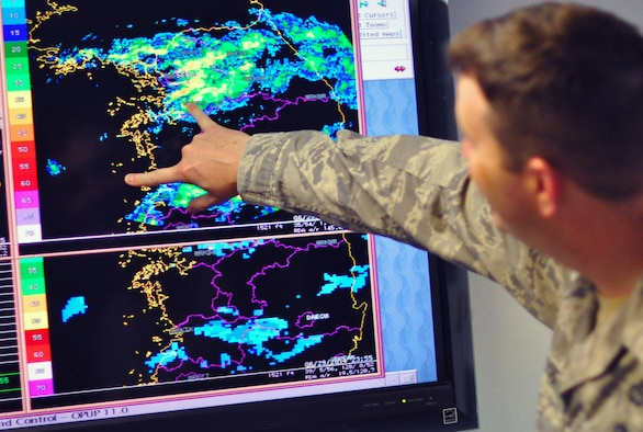 Master Sgt. Brian Nuss, the 51st Operations Support Squadron Weather Flight chief, shows how far another patch of storms is from Osan June 30, 2011 on the base's weather radar. Forecaster's here provide timely and accurate tactical weather support relevant to the needs of the 51 Fighter Wing and tenant units in order to support continuous air operations. (U.S. Air Force photo/Tech. Sgt. Chad Thompson)