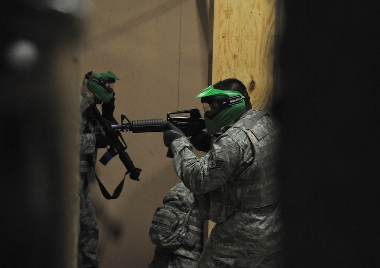 Airmen from the 161st Air Refueling Wing Security Forces Squadron received  close quarters tactic training at a local airsoft course in Gilbert Ariz., August 13, 2011. The training facility provides several real world scenarios in an urban enviroment to prepare Airmen for combat. (Released/ U.S. Air Force A1C Rashaunda Williams.)