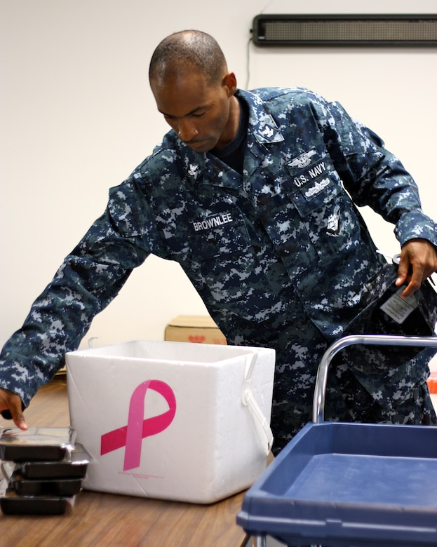 SAN ANGELO, Texas -- Navy Petty Officer 2nd Class David Brownlee packs meals that he and his team will deliver to the homes of those participating in the Meals for the Elderly program Aug. 12. (Courtesy photo/Whitney Haskell)