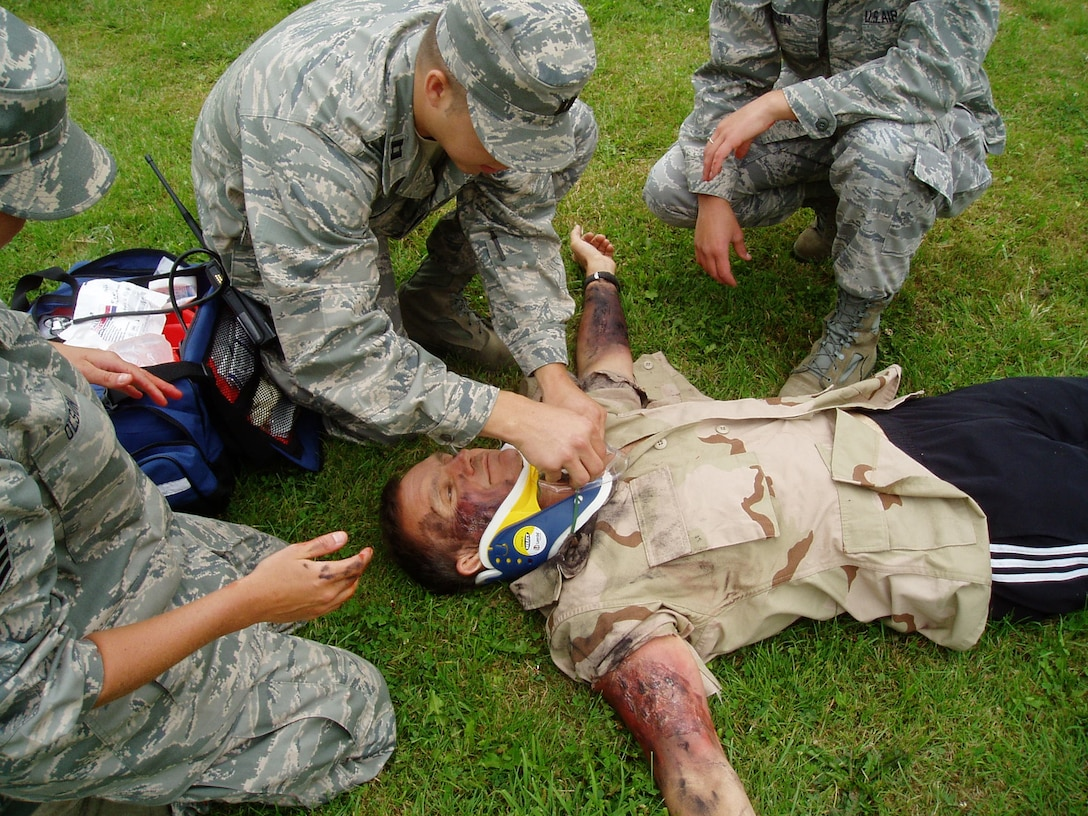 148th Fighter Wing Medical Group members Capt. Aaron Jordan, Staff Sgt. Alex Olson, and Staff Sgt. Amanda Roen attend to a victim during a Mass Casualty Exercise at Spangdahlem Air Base, Germany July 29, 2011.  The 148th deployed more than 30 members to Spangdahlem Air Base for 13 days of hands-on training.