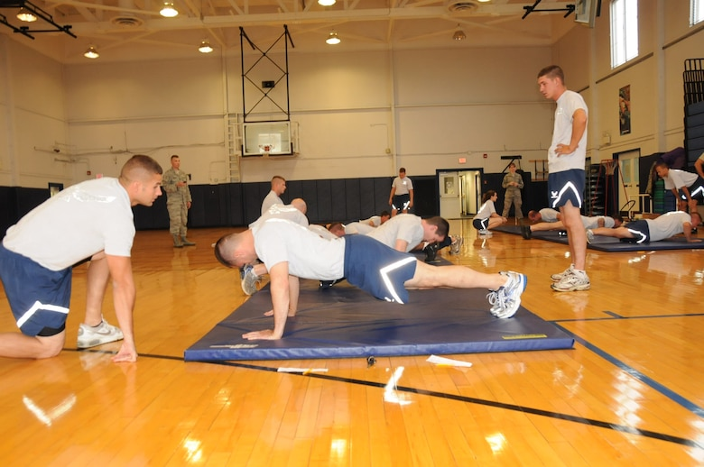 107th members conduct their physical training test at the base fitness center during the UTA weekend. Fitness monitors count pushups and make corrections as needed. (Air Force Photo/SMSgt Ray Lloyd)