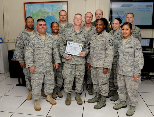 Staff Sgt. Robert Koon, 36th Wing Command Post senior emergency action controller, was awarded Team Andersen's Best here, July 27. Andersen's Best is a recognition program which highlights a top performer from the 36th Wing. Each week, supervisors nominate a member of their team for outstanding performance and the wing commander presents the selected Airman/Civilian with an award. (U.S. Air Force photo by Senior Airman Benjamin Wiseman)