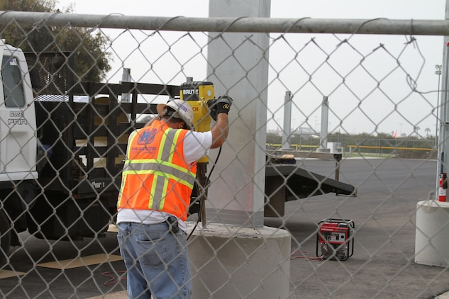 A construction worker builds onto a support beam for a new parking area aboard Marine Corps Recruit Depot San Diego Aug. 16. This is no ordinary parking area, the roof will be lined with solar hot water heating panels. This is just one part of an energy saving project that will help MCRD go green.