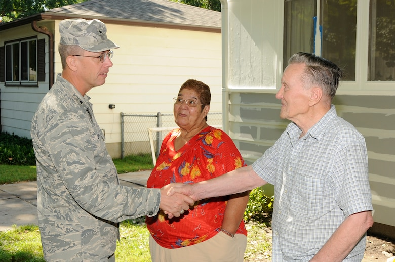 Brig. Gen. Daryl L. Bohac shakes the hands of Norman and Gloria Phillips, recipients of the Nebraska National Guard's annual Paint-a-thon in Lincoln, Neb. on Aug. 13, 2011. The Phillips' were nominated by applying for assistance through the Lincoln Action Program. (Nebraska Air National Guard photo by Master Sergeant Vern Moore) (Released)