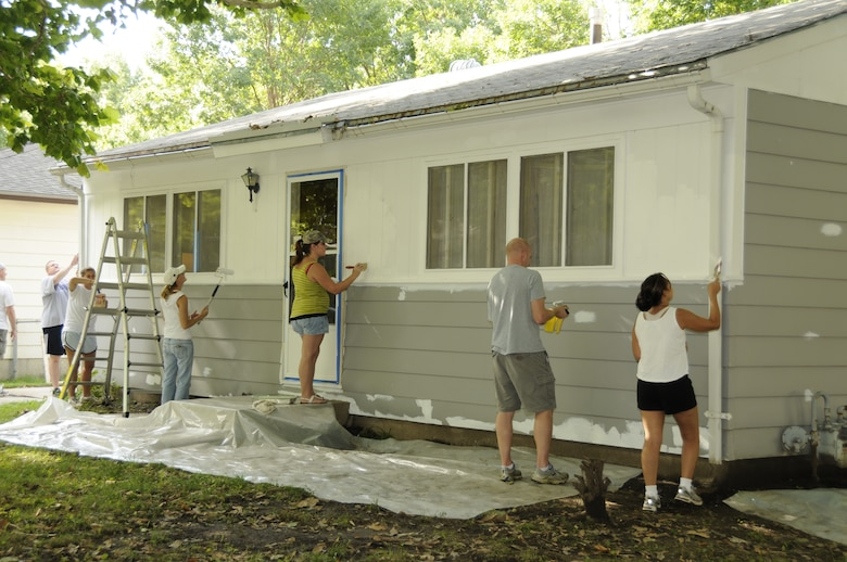 Members from the Nebraska Air and Army National Guard paint a house during the National Paint-a-thon in Lincoln, Neb. on Aug. 13, 2011. The Paint-a-thon is a program through the Lincoln Action Program to assist disabled, elderly, or financially unstable homeowners to preserve their home with a fresh coat of paint.  (Nebraska Air National Guard photo by Master Sergeant Vern Moore) (Released)