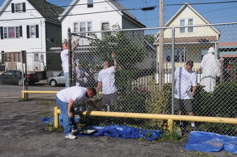 On the morning of Aug. 17th, 20 members of the 107th Airlift Wing converged at the Corpus Christi Church in Buffalo, NY, to give the grounds a much needed facelift. The members armed with scrapers, brushes, and rollers donned their protective gear and attacked the surrounding fences, guard rails and basement windows with a fresh coat of paint. (U.S. Air Force Photo/Staff Sgt. Peter Dean)