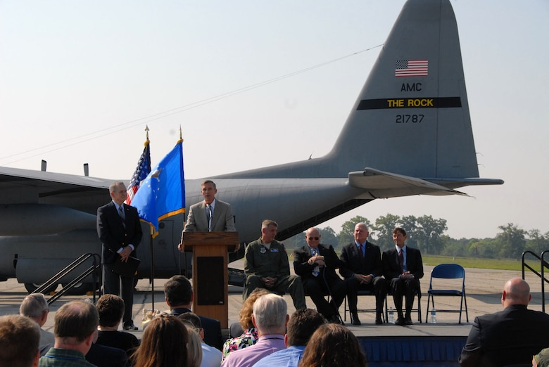 "DAYTON, Ohio -- Lt. Gen. (Ret.) John L. ""Jack"" Hudson, director of the National Museum of the U.S. Air Force, addresses the audience after the C-130E made its final flight on Aug. 18, 2011. Ceremony speakers included (from left to right) Col. Michael A. Minihan, commander of the 19th Airlift Wing; Col. (Ret.) William Caldwell, who received the Air Force Cross while piloting the aircraft during the Southeast Asia War; Col. (Ret.) James Grant, vice president of Air Mobility and Special Operations Programs for Lockheed Martin Aeronautics Co.; and Col. (Ret.) Pete Gavares, vice president of USAF Programs for Rolls-Royce North America, Inc. (U.S. Air Force photo by Jeff Fisher)"