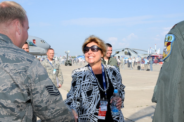Ms. Hedi Grant, Secretary of the Air Force International Affairs, shakes hands with Tech. Sgt. Danny Turner, 81st Aircraft Maintenance Squadron, during her tour of the U.S. European Command's area at the Moscow International Aviation and Space Salon, or MAKS 2011, Aug. 17. MAKS is one of the premier events of its type in the world and Department of Defense participation demonstrates the United States commitment to international security, promotes international cooperation, and contributes to U.S. foreign policy objectives.  The U.S. Air Force has a KC-10 Extender, two F-16C Fighting Falcons, two A-10 Thunderbolt II, one F-15E Strike Eagle, one B-52 Stratotanker, C-130J Super Hercules and C-5M Galaxy statics for the show.