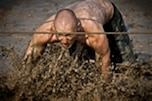 A runner navigates an obstacle during the 11th annual Armed Services YMCA Mud Run at Joint Expeditionary Base Little Creek-Fort Story in Virginia Beach, Va., Aug. 13, 2011. All proceeds from the 8-kilometer race benefit the Armed Services YMCA of Hampton Roads.