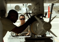 Staff Sgt  Robert Corso steadies the MJ-1B Jammer delivering