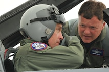 SIOUX FALLS, SD - Lt. Col. Harrison Lippert, 114th Fighter Wing chaplain recieves pre-flight instructions from Col. Russ Walz, 114th Fighter Wing commander prior to his flight in the F-16 aircraft at Joe Foss Field August 16, 2011.  Chaplain Lippert was one of the few select unit members of the South Dakota Air National Guard who recieved a ride in the F-16D this year.(Photo by Master Sgt. Nancy Ausland)(RELEASED)USAF