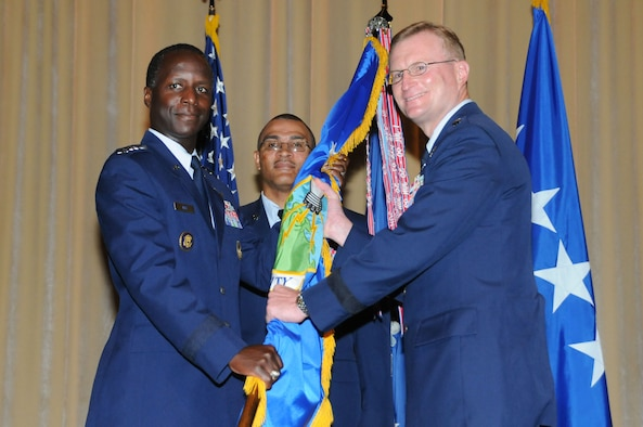 Air Education and Training Command Commander Gen. Edward Rice Jr. hands the Air University guidon to Lt. Gen. David Fadok, new Air University commander and president, during a change of command ceremony Aug. 12. (Air Force photo/Chris Baldwin)