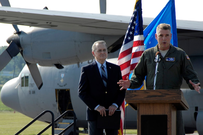 DAYTON, Ohio -- Col. Michael A. Minihan, commander of the 19th Airlift Wing, addresses the audience after the C-130E made its final flight on Aug. 18, 2011. Col. Minihan piloted the aircraft on its final flight. (U.S. Air Force photo by Michelle Gigante)