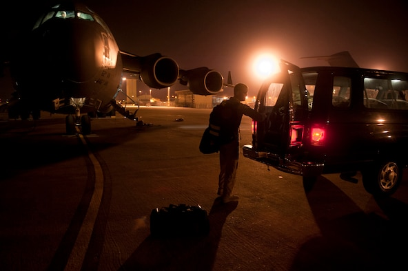 Capt. Eric Bowers, an 817th Expeditionary Airlift Squadron pilot, unloads flight equipment from a C-17 Globemaster III aircraft into a van after a flight Aug. 18, 2011, at Incirlik Air Base, Turkey. The crew transported equipment and supplies from Incirlik to Kandahar Air Field, Afghanistan. (U.S. Air Force photo by Tech. Sgt. Michael B. Keller/Released)
