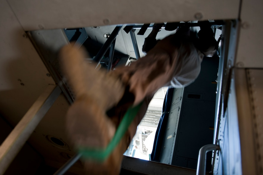 Staff Sgt. Melissa Butterfield, an 817th Expeditionary Airlift Squadron loadmaster, does pull-ups with the help of a rubber band onboard a C-17 Globemaster III aircraft Aug. 18, 2011, while flying over Afghanistan. The crew transported equipment and supplies from Incirlik Air Base, Turkey, to Kandahar Air Field, Afghanistan. (U.S. Air Force photo by Tech. Sgt. Michael B. Keller/Released)