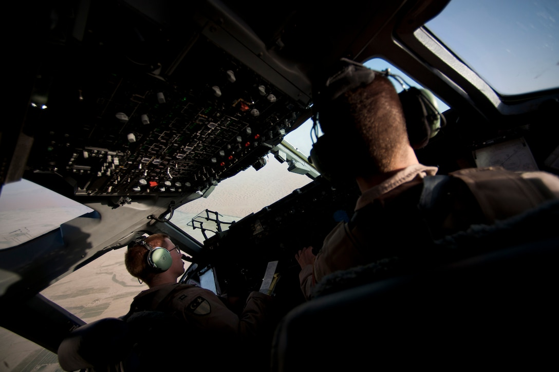 Capts. Matt Hammerle, left, and Eric Bowers, 817th Expeditionary Airlift Squadron pilots, takeoff in a C-17 Globemaster III aircraft Aug. 18, 2011, at Kandahar Air Field, Afghanistan. The crew transported equipment and supplies from Incirlik Air Base, Turkey. (U.S. Air Force photo by Tech. Sgt. Michael B. Keller/Released)