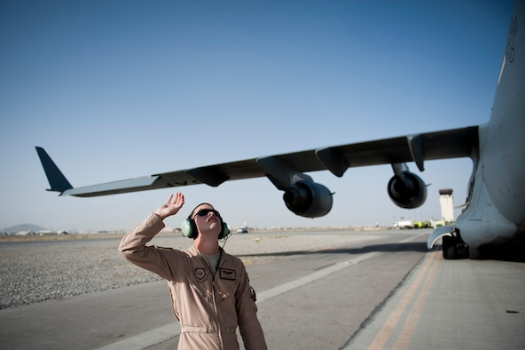 Capt. Eric Bowers, an 817th Expeditionary Airlift Squadron pilot, inspects a Globemaster III aircraft Aug. 18, 2011, before a flight at Kandahar Air Field, Afghanistan. The crew transported equipment and supplies from Incirlik Air Base, Turkey. (U.S. Air Force photo by Tech. Sgt. Michael B. Keller/Released)