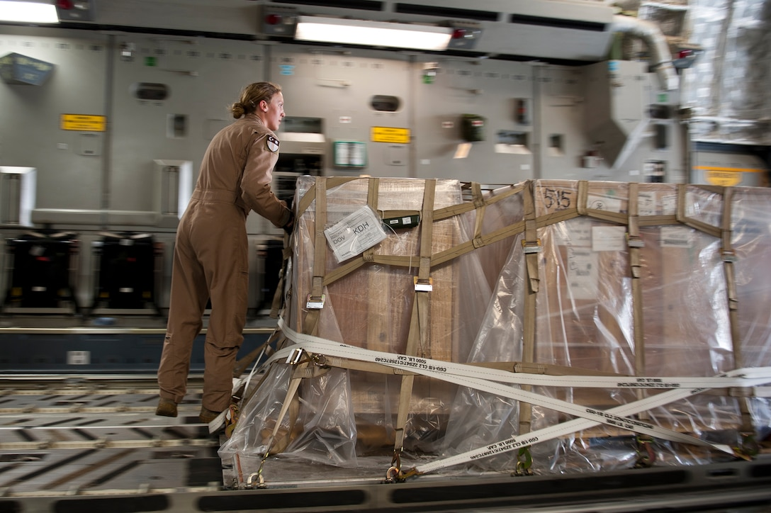 Staff Sgt. Melissa Butterfield, an 817th Expeditionary Airlift Squadron loadmaster, pushes a pallet of cargo while unloading a C-17 Globemaster III aircraft Aug. 18, 2011, at Kandahar Air Field, Afghanistan, during a mission to transport equipment and supplies from Incirlik Air Base, Turkey. Loadmasters not only ensure the cargo is properly secured during flight, but also help with the unloading. (U.S. Air Force photo by Tech. Sgt. Michael B. Keller/Released)
