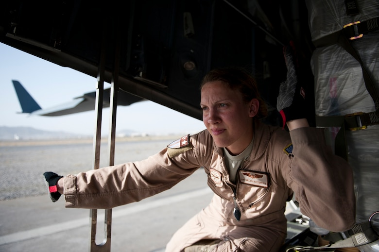 Staff Sgt. Melissa Butterfield, an 817th Expeditionary Airlift Squadron loadmaster, directs equipment to unload a C-17 Globemaster III aircraft Aug. 18, 2011, at Kandahar Air Field, Afghanistan, during a mission to transport equipment and supplies from Incirlik Air Base, Turkey. Loadmasters not only ensure the cargo is properly secured during flight, but also help with the unloading. (U.S. Air Force photo by Tech. Sgt. Michael B. Keller/Released)