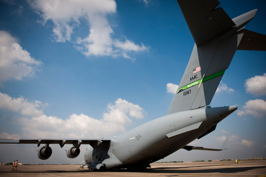 Capts. Matt Hammerle, left, and Eric Bowers, 817th Expeditionary Airlift Squadron pilots, inspect a C-17 Globemaster III aircraft before a flight Aug. 18, 2011, at Incirlik Air Base, Turkey. The crew transported equipment and supplies to Kandahar Air Field, Afghanistan. (U.S. Air Force photo by Tech. Sgt. Michael B. Keller/Released)