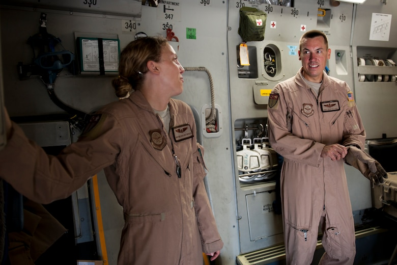 Staff Sgts. Melissa Butterfield, left, and Sean Sullivan, 817th Expeditionary Airlift Squadron loadmasters, share a laugh onboard a C-17 Globemaster III aircraft Aug. 18, 2011, at Incirlik Air Base, Turkey, prior to a mission to transport equipment and supplies to Kandahar Air Field, Afghanistan. Loadmasters are responsible for ensuring cargo is properly loaded and secured. (U.S. Air Force photo by Tech. Sgt. Michael B. Keller/Released)