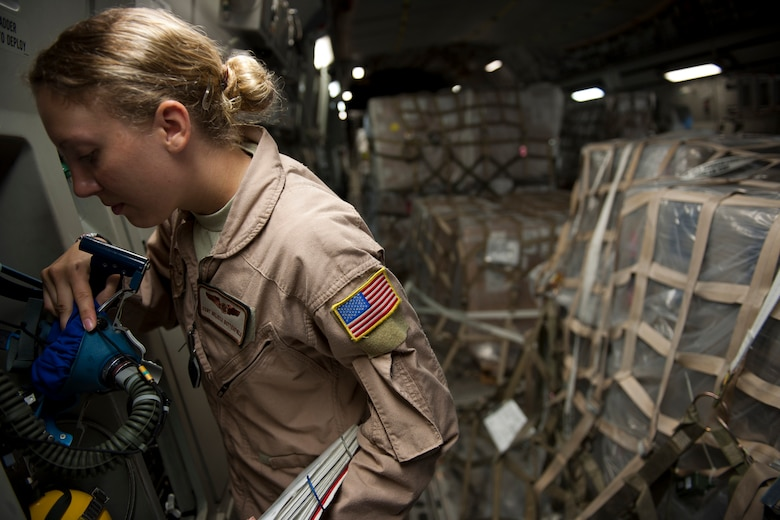 Staff Sgt. Melissa Butterfield, an 817th Expeditionary Airlift Squadron loadmaster, inspects an oxygen mask onboard a C-17 Globemaster III aircraft Aug. 18, 2011, at Incirlik Air Base, Turkey, prior to a mission to transport equipment and supplies to Kandahar Air Field, Afghanistan. Loadmasters ensure the cargo is properly secured in addition to monitoring the condition of emergency equipment. (U.S. Air Force photo by Tech. Sgt. Michael B. Keller/Released)