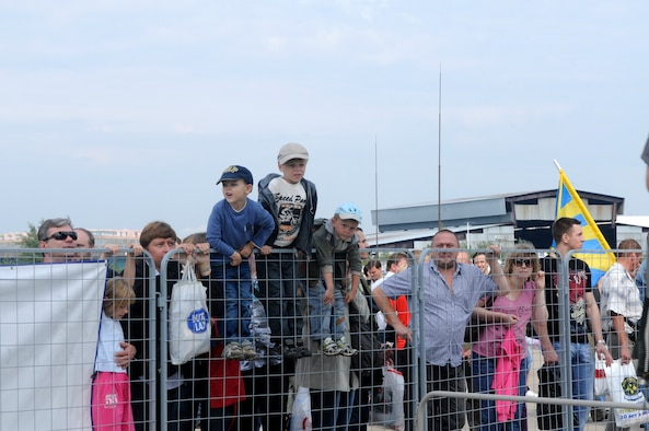 ZHUKOVSKY AIR FIELD, Russia – Children climb the fence while waiting for their turn to tour the C-5M Galaxy from Dover Air Force Base, Del., at the Moscow International Aviation and Space Salon, or MAKS 2011, here Aug. 20. MAKS is one of the premier events of its type in the world and Department of Defense participation demonstrates the United States commitment to international security, promotes international cooperation, and contributes to U.S. foreign policy objectives.  The U.S. Air Force has a KC-10 Extender, two F-16C Fighting Falcons, two A-10 Thunderbolt II, one F-15E Strike Eagle, one B-52 Stratotanker, C-130J Super Hercules, C-5M Galaxy, and a U.S. Navy P-3 Orion statics for the show. (U.S. Air Force photo/Master Sgt. Kelley J. Stewart)