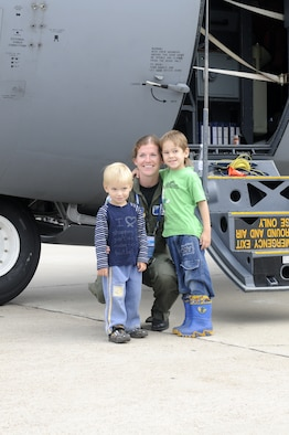 ZHUKOVSKY AIR FIELD, Russia – First Lt. Katie Suhrhoff, 37th Airlift Squadron co-pilot from Ramstein Air Base, Germany, poses for a photo with two Russian children in front of her C-130J Super Hercules at the Moscow International Aviation and Space Salon, or MAKS 2011, here Aug. 20. MAKS is one of the premier events of its type in the world and Department of Defense participation demonstrates the United States commitment to international security, promotes international cooperation, and contributes to U.S. foreign policy objectives.  The U.S. Air Force has a KC-10 Extender, two F-16C Fighting Falcons, two A-10 Thunderbolt II, one F-15E Strike Eagle, one B-52 Stratotanker, C-130J Super Hercules, C-5M Galaxy, and a U.S. Navy P-3 Orion statics for the show. (U.S. Air Force photo/Master Sgt. Kelley J. Stewart)
