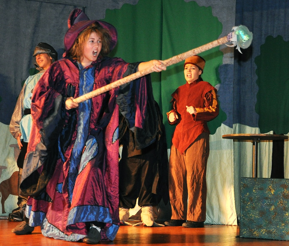 GOODFELLOW AIR FORCE BASE, Texas -- Merlin, played by Mary Kate Willis, tries to cast a spell during the Missoula Children's Theatre production of King Arthur's Quest Aug. 20 at the base theater here. (U.S. Air Force photo/Connie Hempel)