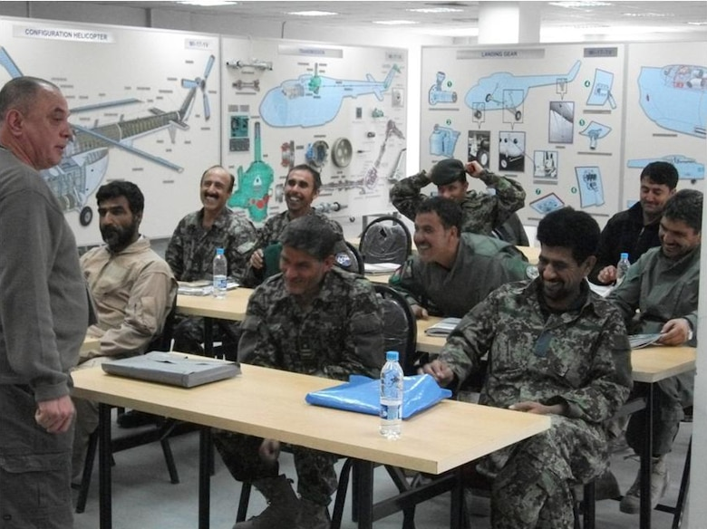 Professor Igor Trygub from the Kharkiv Aviation Institute, Ukraine, addresses Afghan Air Force students after successful completion of their final examination in the intermediate-level Mi-17 helicopter systems and maintenance course August 23, 2011. (U.S. Air Force courtesy photo)