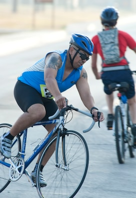Francisco Morales, 39th Security Forces Squadron, turns to finish the 20-kilometer bike ride during the 3rd Annual Sprint Triathlon Aug. 20, 2011, at Incirlik Air Base, Turkey. The triathlon also included a five-kilometer run and a 225-meter swim.(U.S. Air Force photo by Airman 1st Class Clayton Lenhardt/Released)