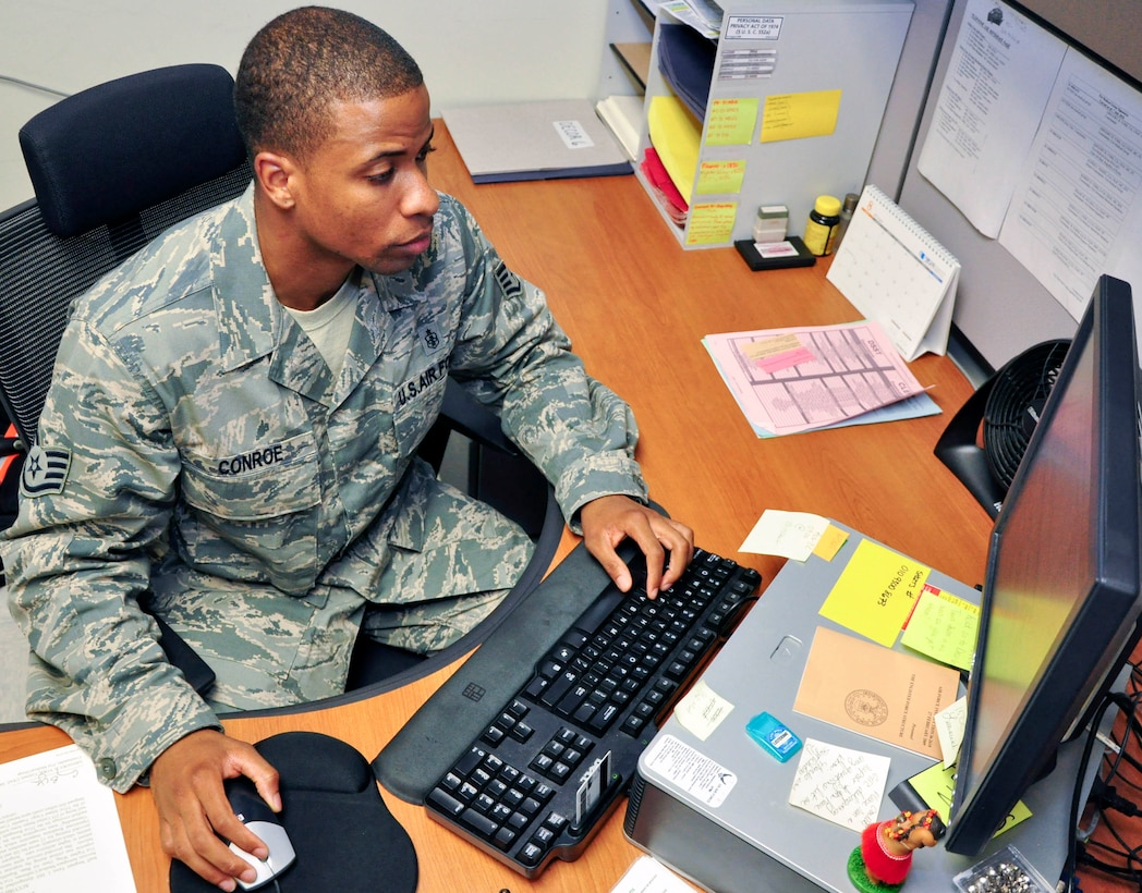 Staff Sgt. Hakim Conroe, 51st Medical Support Squadron, in-processes some paperwork through the 51st Medical Group Commander's Action Group office Aug. 17, 2011. Conroe was recently recognized for his hard work and dedication to his job through the Airman Spotlight program. (U.S. Air Force photo/Tech. Sgt. Chad Thompson)