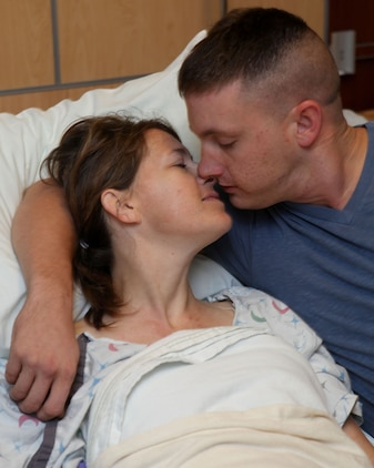 Sergeant Craig Santos, a Marine Air Control Squadron 2 Aviation Supply Specialist, kisses his wife, Angela Santos, after her kidney surgery at the Medical University of South Carolina, Aug. 24. Craig was not a compatible kidney match with Angela but did everything in his power to find her a donor.