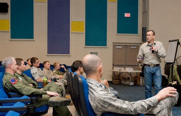 """Retired U.S. Army Lt. Col. David Grossman presents his Bulletproof Mind lecture to approximately 150 Nellis Airmen Aug. 18, 2011, in the base theater at Nellis Air Force Base, Nev. Grossman, author of """"On Killing"""" and """"On Combat,"""" spoke to the Airmen about how external sources can negatively affect the minds of military personnel and what military personnel can do to """"bulletproof"""" their minds against such adversaries. (U.S. Air Force photo by Senior Airman Stephanie Rubi/Released)"""