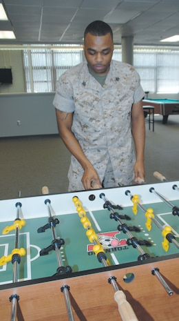 Sgt. Michael C. Barnes, shipping noncommissioned officer, Critical Assets Rapid Distribution Facility, plays a game of foosball at the Single Marine Recreation Center, Aug. 25.