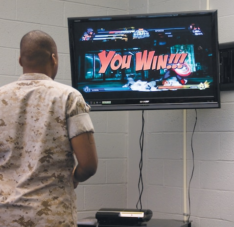 Sgt. Michael C. Barnes, shipping noncommissioned officer, Critical Assets Rapid Distribution Facility, beats his opponent while playing the Xbox at the Single Marine Recreation Center, Aug. 25.