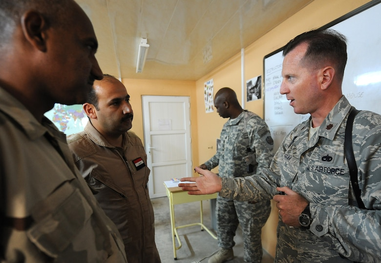 Maj. Mark Gray, 321st Air Expeditionary Advisory Group director of maintenance, meets up with other advisors to help teach the English language two hours a day, four days a week to the Iraqi maintainers at Kirkuk Air Base, Iraq. (U.S. Air Force photo by Senior Airman Tristin English)