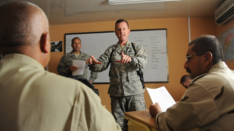 Maj. Mark Gray, 321st Air Expeditionary Advisory Group director of maintenance, helps teach the basics of the English language two hours a day, four days a week to the Iraqi maintainers at Kirkuk Air Base, Iraq.  Iraqi maintenance professionals have to learn the English language because all of their manuals are written in English, and only an estimated 15 out of 200 Iraqi Airmen have knowledge of the language. (U.S. Air Force photo by Senior Airman Tristin English)