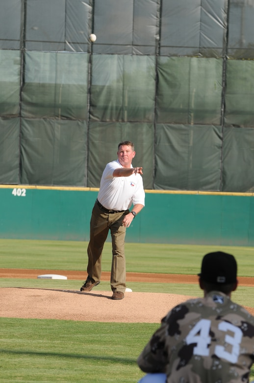 """Major General (Maj. Gen.) John Nichols, Texas' Adjutant General, throws out a ceremonial """"first-pitch"""" during Texas Air National Guard night with the San Antonio Missions AA baseball club, August 21, 2011.  (Air National Guard photo by SSgt Eric L. Wilson/Released)"""