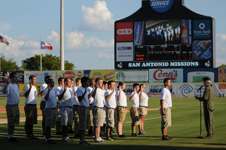 Colonel (Col) John Kane, commander of the 149th Fighter Wing, swears in new recruits into the unit during Texas Air National Guard night with the San Antonio Missions AA baseball club, August 21, 2011.  (Air National Guard photo by SSgt Eric L. Wilson/Released)