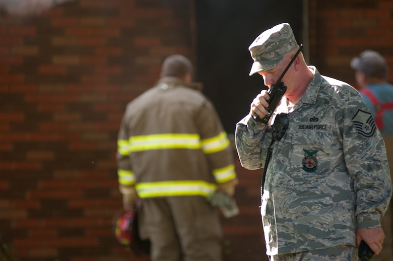 Airmen from the Missouri Air National Guard's 139th Airlift Wing Fire Department respond to a house fire in Elwood, Ks., on August 25, 2011. The airmen were called to assist a mutual aid with the Doniphan County Volunteer Fire Department. (U.S. Air Force photo by Senior Airman Sheldon Thompson)