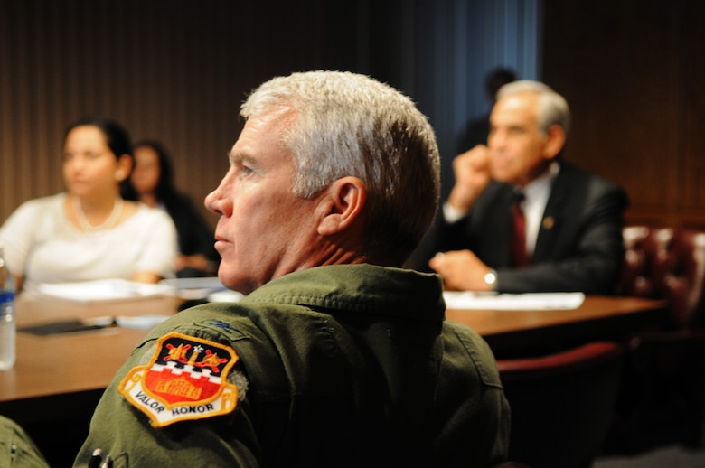 Col. Michael Kelley, vice wing commander of the Texas Air National Guard?s 149th Fighter Wing at Lackland AFB, Texas, listens to a presentation given by the unit?s wing commander, Col. John Kane, during a visit to the F-16 training unit by U.S. Rep. Charlie Gonzalez (TX-20) of San Antonio (right), August 18, 2011. (Air National Guard Photo by SSgt Phil Fountain/Released)(U.S. Air Force photo/Staff Sergeant Phil Fountain)