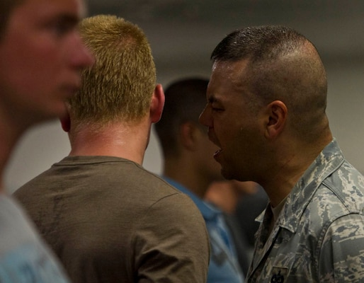 Tech. Sgt. Trevor Tiernan, 321st Training Squadron military training instructor, corrects a trainee Aug. 2 during the first few minutes of zero week at Lackland Air Force Base. (U.S. Air Force photo/Staff Sgt. Araceli Alarcon)