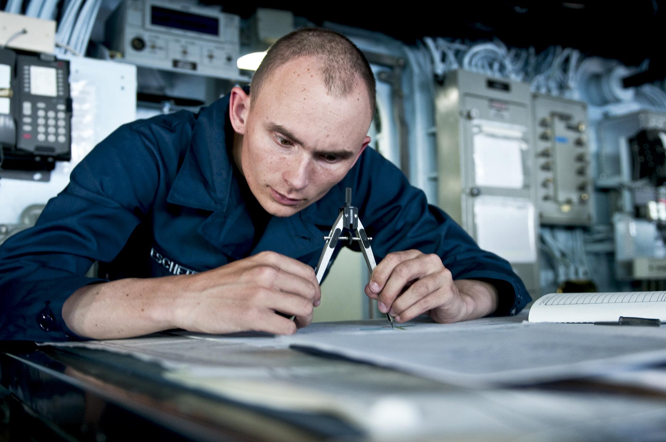 navy seaman michael eschete tracks course of the amphibious assault ship uss wasp as it departs