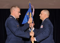 Lt. Col. James Chappelear, 56th Intelligence Squadron commander, accepts the guidon from Lt. Col. Daniel Settergren, 23rd Air Force vice commander, at Cannon Air Force Base, N.M., Aug. 26, 2011. While the 56th IS is based at Cannon, it is commanded by the 23rd Air Force which is stationed at Hurlburt Field, Fla. (U.S. Air Force photo by Airman 1st Class Ericka Engblom)