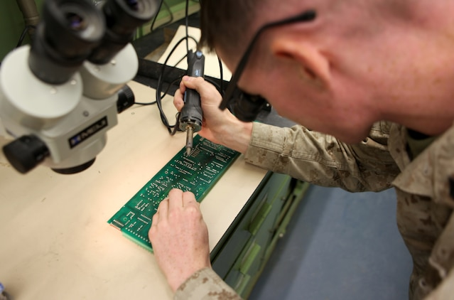Cpl. Zachary Moats, a radio repairman with Communications Electronic Maintenance platoon, 2nd Marine Logistics Group (Forward) solders a new component into place on a circuit card aboard Camp Leatherneck, Afghanistan, Aug. 31. During the last six months, the section has saved quite a significant amount of money performing repairs like this - $105,000 to be exact, while only spending approximately $800 on repair parts. (U.S. Marine Corps photo by Lance Cpl. Bruno J. Bego)