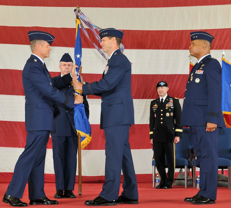 Gen. William M. Fraser, left, Air Combat Command commander, passes the 1st Air Force flag to Lt. Gen. Sid Clarke during the Continental U.S. North American Aerospace Defense Command Region-1st Air Force (Air Forces Northern) change of command ceremony at Tyndall Air Force Base, Fla., Aug. 31. Clarke assumed command of 1st Air Force from Maj. Gen. Garry C. Dean, marking the first time a lieutenant general has ever held a command billet at Tyndall. (U.S. Air Force photo by Lisa Norman)