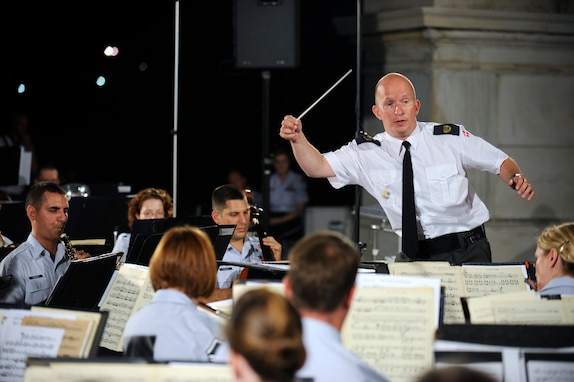International guest conductor from Denmark, Captain Martin Åkerwall, conducts the U.S. Air Force Concert Band at the U.S. Capitol on August 16. Captain Åkerwall is the conductor of the Band of the Royal Danish Life Guards. (U.S. Air Force photo by Staff Sgt. Raymond Mills)