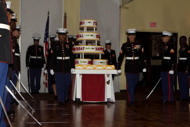 U.S. Marines with Combat Logistics Battalion 31, 31st Marine Expeditionary Unit escort the birthday cake during the Marine Corps' 236th birthday celebration at the Butler Officers Club, Plaza Housing, Okinawa, Japan on December 1, 2011. The Marine Corps Birthday Ball is an annual tradition celebrated throughout the entire Marine Corps. The 31st MEU is the only continually forward-deployed MEU, and remains the United States' force in readiness in the Asia-Pacific region.